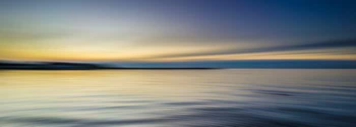Calm sea with sunrise